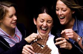 women eating chocolate