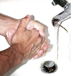 man with OCD washing hands