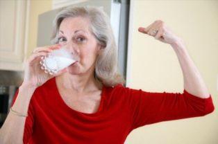 old woman drinking milk