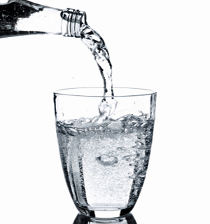 pouring water in a glass