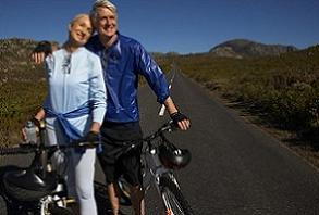 senior couple cycling for fitness