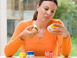 woman checking weight loss supplements