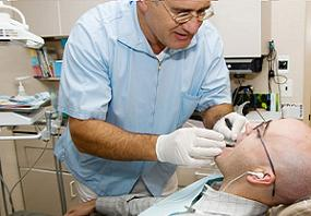 dentist performing periodontal flap surgery