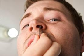 man clipping his nose hair
