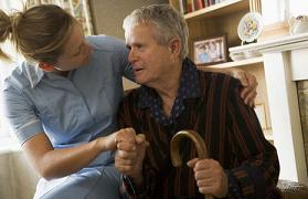 Nurse aiding a Parkinson's disease sufferer
