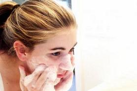 Woman using rosacea face soap.
