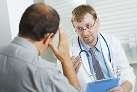 doctor discussing with patient about inguinal hernia treatment