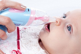 mother using a nasal aspirator