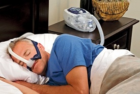 man using the cpap machine