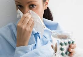 woman with flu ingesting sinutab