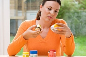 woman checking medication side effects