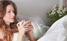 woman drinking chamomile tea for insomnia